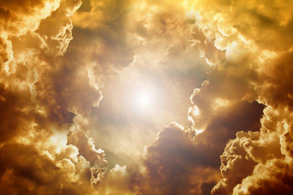 Sun coming through clouds